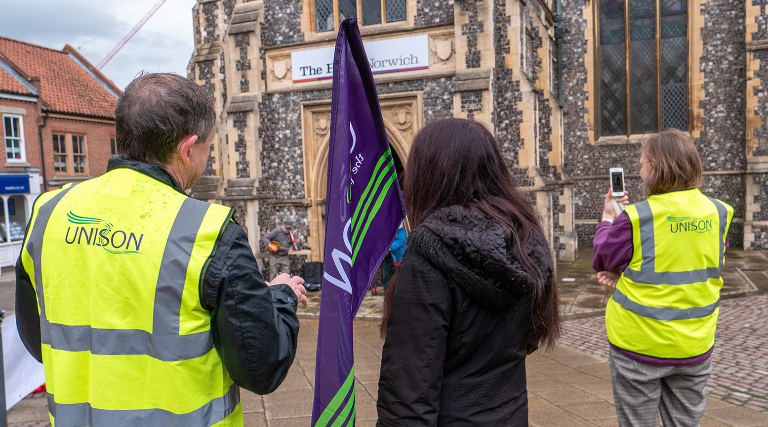 UNISON activists protest outside the Halls in Norwich