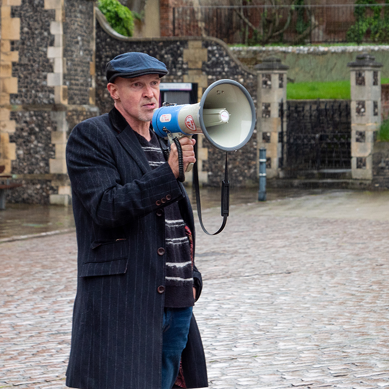 A man speaks through a megaphone