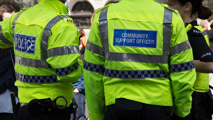 Police community support officers seen from behind